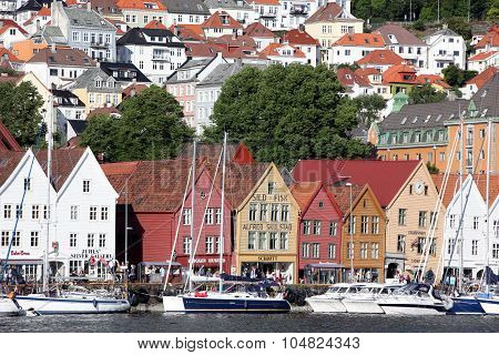 Bergen, Norway - Circa July 2012: Tourists And Locals Stroll Along The Unesco World Heritage Site, B