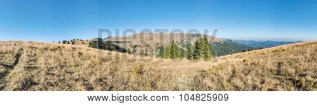 Panorama Of Mountains Ridge Under Blue Sky In Late Summer