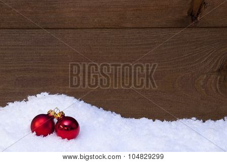 Wooden Christmas Background On Snow, Red Balls As Decoration
