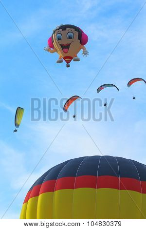 Hot Air Balloons And Paragliders