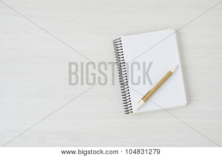 Notepad With A Pen On White Wood Background