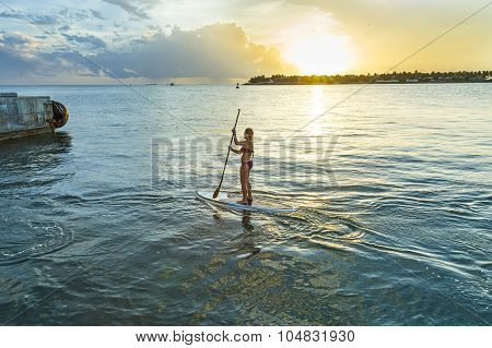 Woman Enjoys Stand Up Paddle Surfing In Key West