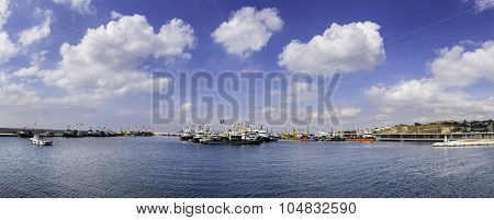Panoramic view of fish trawler and fishing boats in new Buyukcekmece fishing port in Istanbul