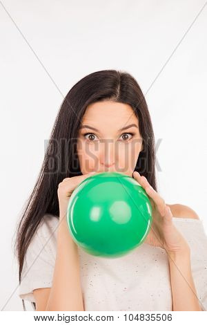 Funny Girl Inflating A Green Balloon