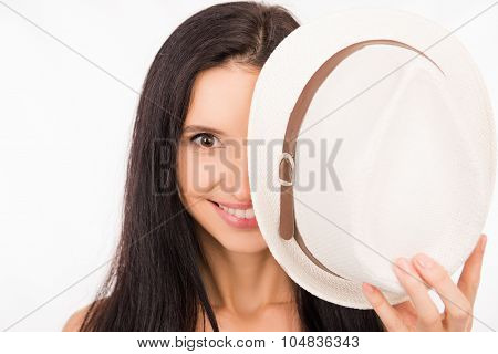 Cute Happy Young Woman Hiding Half Of The Face Behind Hat