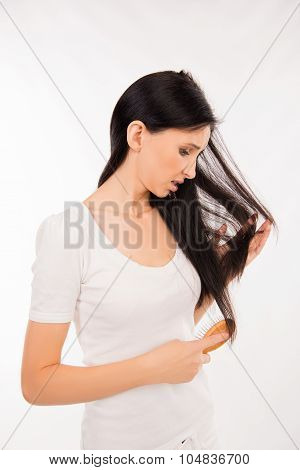 Young Brunette Woman Brushing Her Hair And Disappointing Condition Her Hair
