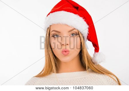 Happy Cute Girl In Santa Hat Pouting