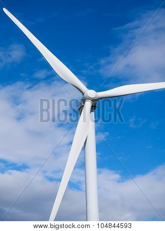 Wind Turbine Top Close-up On Blue Sky