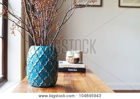Horizontal Moroccan Teal Vase With Clear Space For Text On White Wall