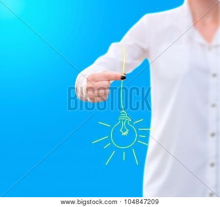 conceptual image , showing a woman holding a sketched light bulb