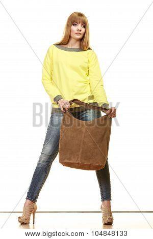 Woman Holds Brown Fringe Handbag