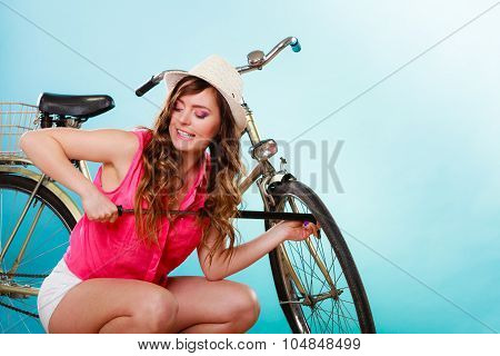 Woman Pumping Up Tire With Bike Pump.