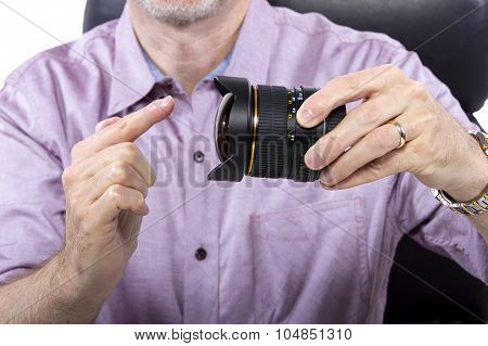 Photographer Showing How To Use Equipment