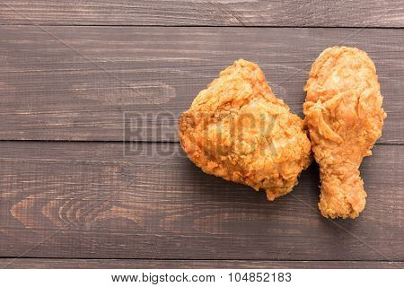 Fried Chicken Breast And Chicken Drumstick On A Wooden Background