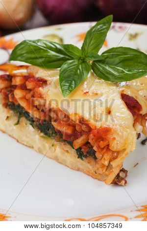 Pasticcio or pastitsio with chard and tomato sauce, italian baked pasta