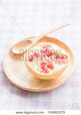Juicy Pomegranate On Wooden Plate