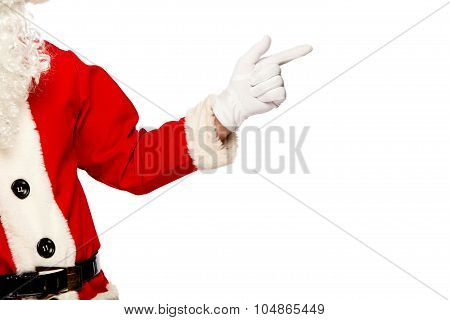 Santa Claus pointing sign with smile, isolated on white background