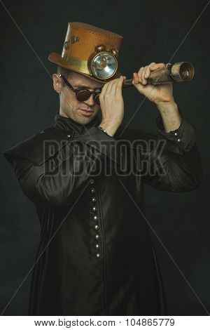 Steampunk Man In A Long Coat Looking Through A Telescope.