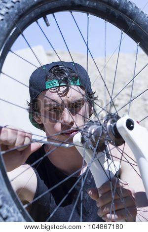 Boy Fixing The Bmx Bike Wheel