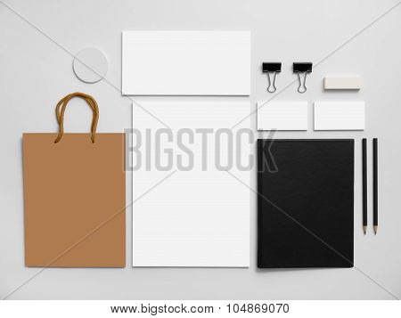 Branding mockup with shopping bag. Stationery on gray.