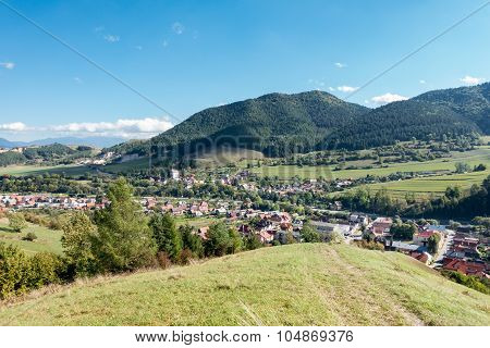 Village Under Hills And Blue Sky