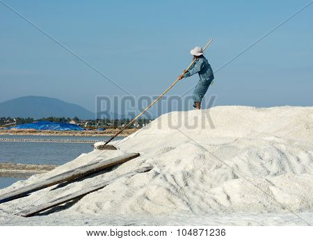 Vietnamese Person Working On The Salt Field