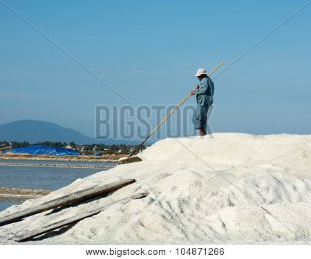 Vietnamese Man Working On The Salt Field