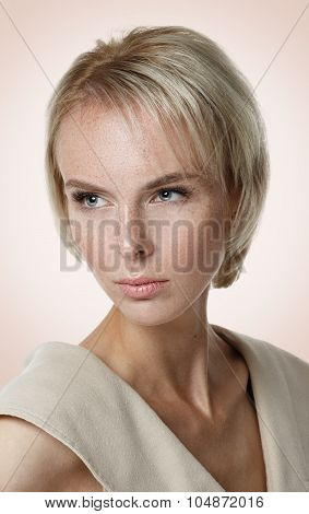 Beautiful Blond Model With Freckles Looking Off Camera