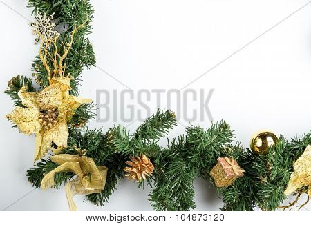 Christmas fir tree branch with golden decoration