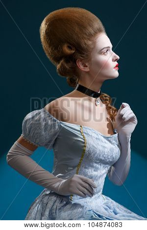 Theatre. Fairy Tale. Fancy Woman In A Blue Dress - Retro Hairstyle.