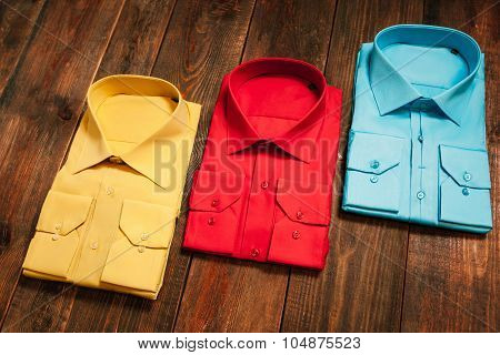 Colorful Men's Shirts On A Wooden Background
