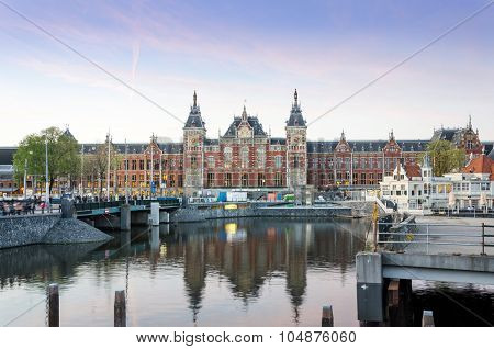 Amsterdam, Netherlands - May 8, 2015: Tousits At Amsterdam Central Train Station