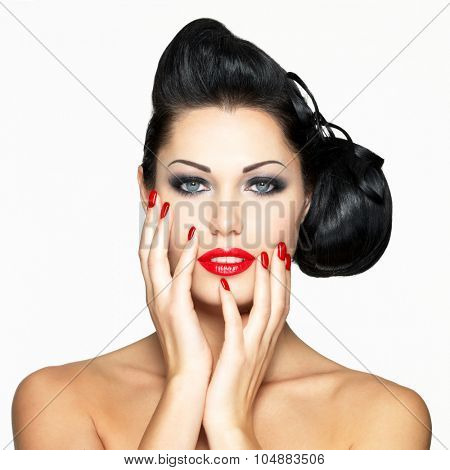Beautiful fashion woman with red lips, nails and creative hairstyle - isolated on white background