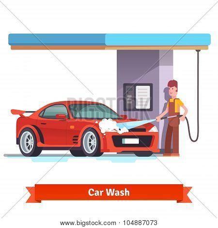 Car wash specialist washing red sports car