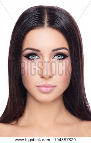 Portrait of young beautiful woman with long straight hair and stylish winged eyes over white background