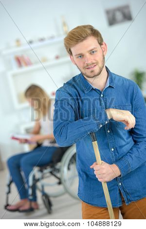 Sweeping up for his disabled girlfriend