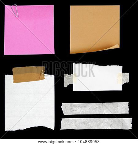 Pieces of paper and adhesive tape on black