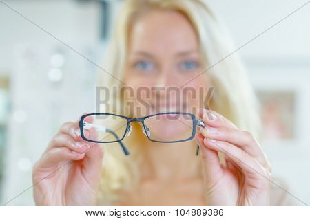 Woman holding spectacles