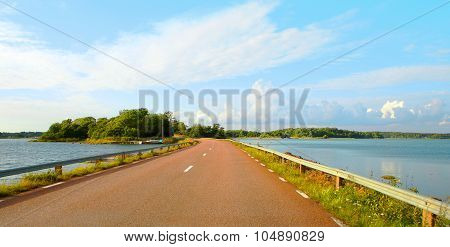 Red Gravel Road In Aland Islands.