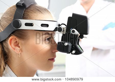 An eye exam at an ophthalmologist, ophthalmoscope