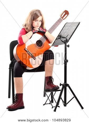 Girl with guitar and musical note stand