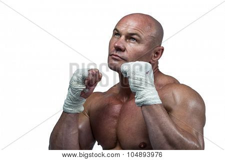 Fighter with fighting stance looking up against white background