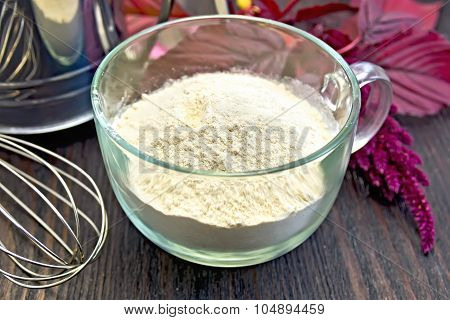 Flour Amaranth In Glass Cup With Sieve On Board