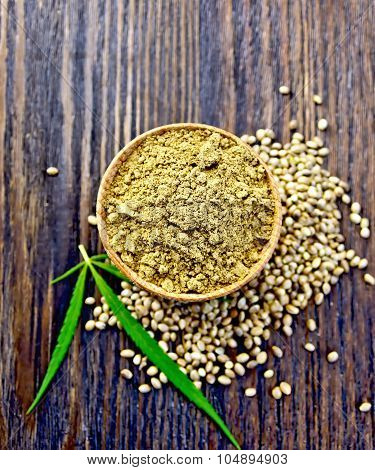 Flour Hemp In Spoon With Leaf On Board