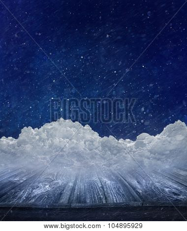 Winter landscape with snow covered wooden table