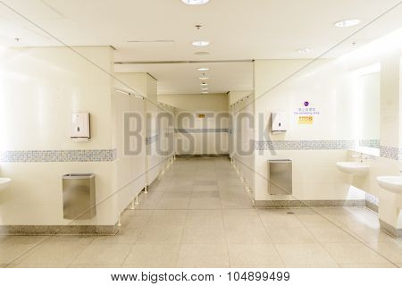 HONG KONG - APRIL 22, 2014: Hong Kong International Airport toilet interior. Hong Kong International Airport is the main airport in Hong Kong. It is located on the island of Chek Lap Kok