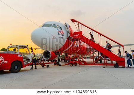KUALA LUMPUR, MALAYSIA - MAY 02, 2014:  AirAsia flight in the airport. AirAsia Berhad is a Malaysian low-cost airline headquartered near Kuala Lumpur, Malaysia