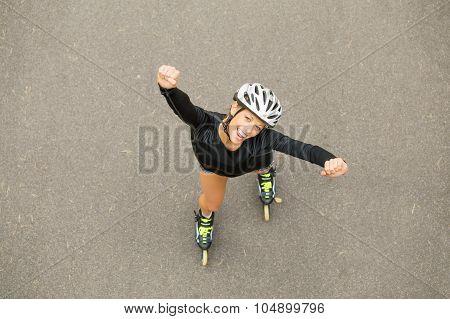 Happy woman on rollerskates