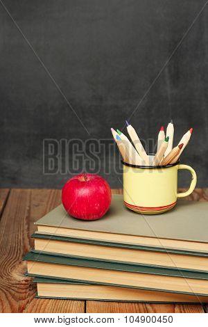 Pencils In A Mug, Books And Apple