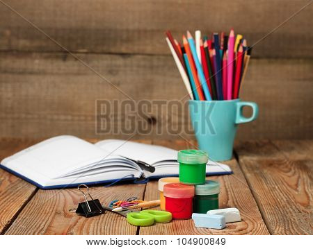 School Supplies And Open Notebook